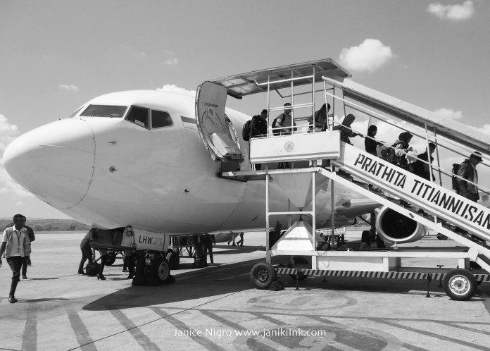 Exiting the plane at Kupang.