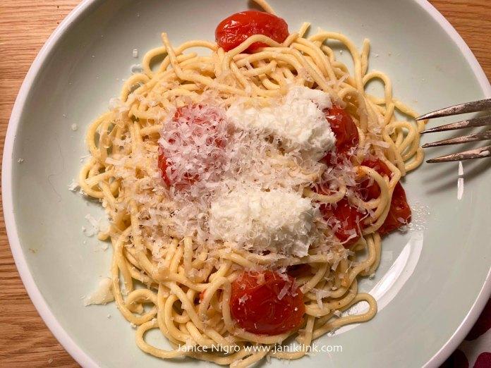 Spaghetti with fresh tomatoes, garlic, mozzarella, and parmigiano